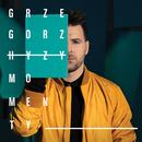 Momenty/Grzegorz Hyzy