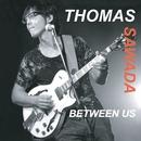 BETWEEN US/THOMAS SAWADA