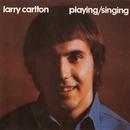 Singing / Playing/Larry Carlton